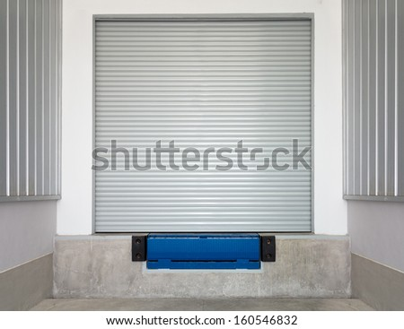 Dock leveler and shutter door,  use for product transfer  to truck. - stock photo