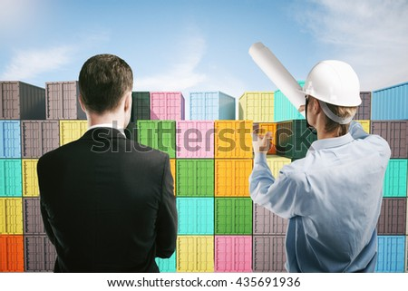 Dock worker pointing at colorful cargo containers and explaining something to businessman. 3D Rendering - stock photo