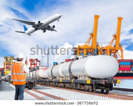 Dock worker talking with radio communication against freight train for fuel transport and cargo plane in front of the harbor, logistic import export concept - stock photo