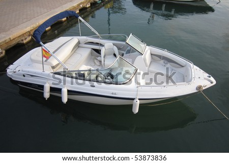 Docked boat in port - stock photo