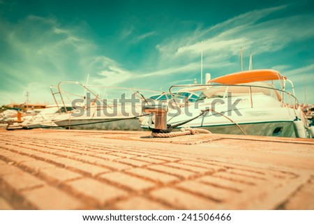 Docked boat in port.docking on the pier in the Mediterranean - stock photo