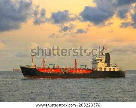 Docked LPG cargo ship at sunrise - stock photo