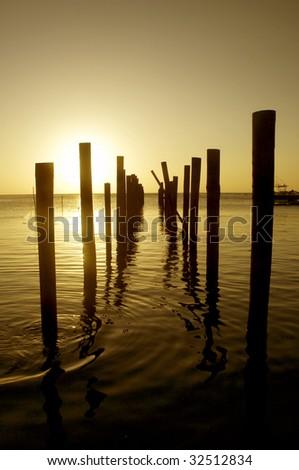 Docking poles in Roatan - stock photo