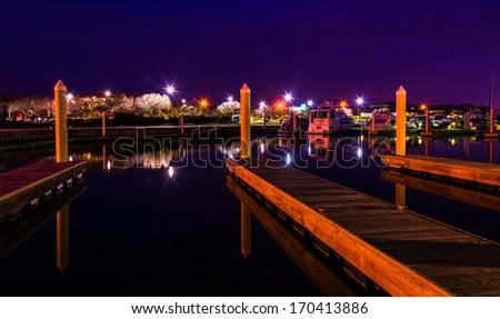 Docks in a marina at night, Kent Island, Maryland. - stock photo