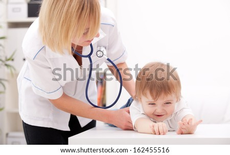 Doctor and child - stock photo