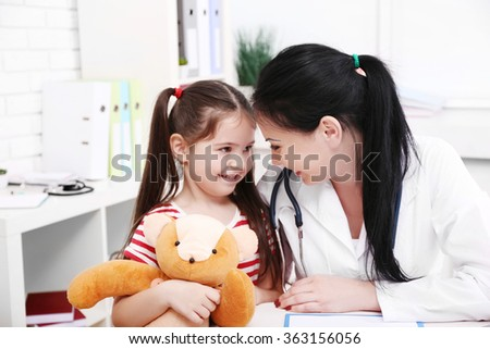 Doctor and child in the office - stock photo