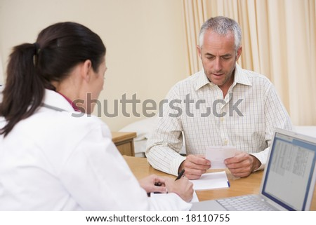 doctor and male patient talking - stock photo