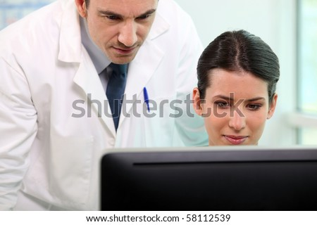 Doctor and medical assistant