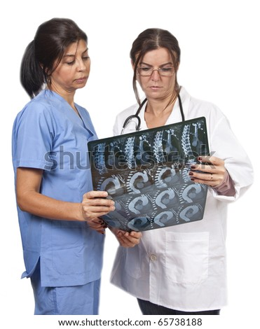 Doctor and nurse examining radiology