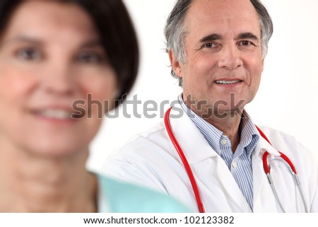 doctor and nurse posing together - stock photo