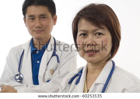 Doctor and Nurse standing with white background - stock photo