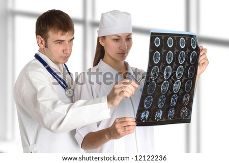 doctor and nurse studies picture in hospital - stock photo