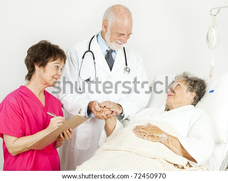 Doctor and nurse treating senior woman in the hospital. - stock photo