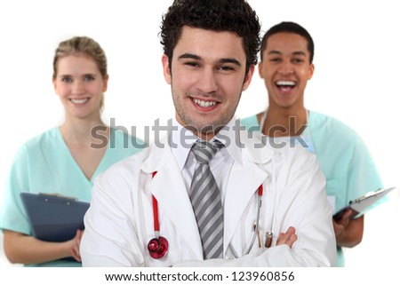 Doctor and nurses laughing - stock photo