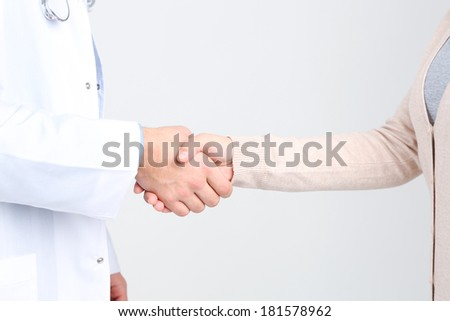 Doctor and patient, close-up,  isolated on white background - stock photo