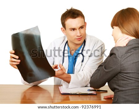 Doctor and patient examining x-ray isolated on white background - stock photo