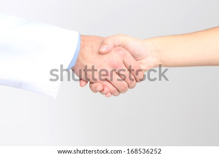 Doctor and patient, isolated on white background - stock photo