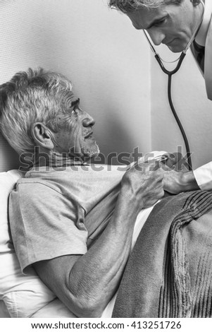 Doctor and patient. Measurement of blood pressure in a hospital. - stock photo