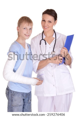 Doctor and young boy with a broken arm - stock photo