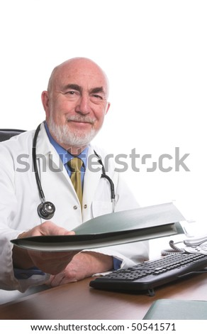 Doctor at his desk - stock photo