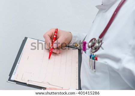 Doctor cardiologist examines cardiogram