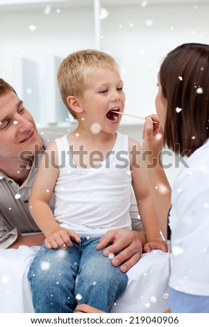 Doctor checking a childs throat with snow falling - stock photo