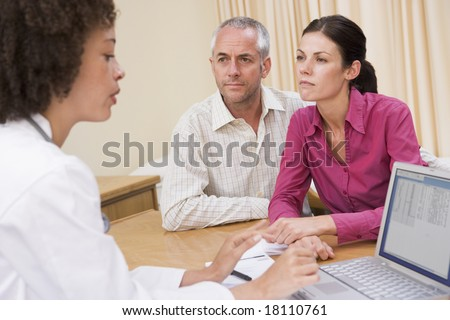 doctor checking couples details