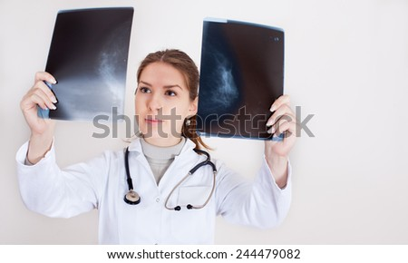 Doctor checking x-ray - stock photo
