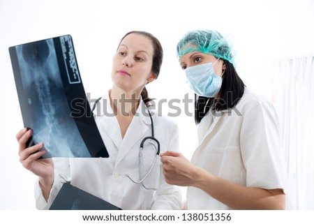 Doctor checking X-ray image - stock photo