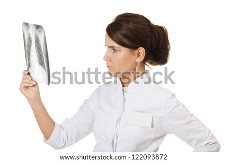 Doctor checking X-ray image on isolated white - stock photo