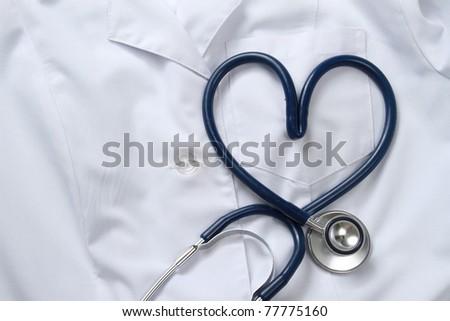 Doctor coat with stethoscope - stock photo