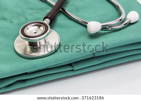 Doctor coat with stethoscope on the desk