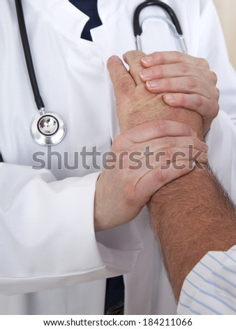 Doctor comforting patient - stock photo