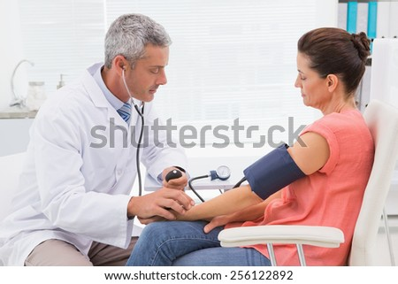 Doctor doing test at his patient in medical office