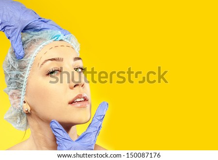 Doctor examines a patient before surgery on the face - stock photo