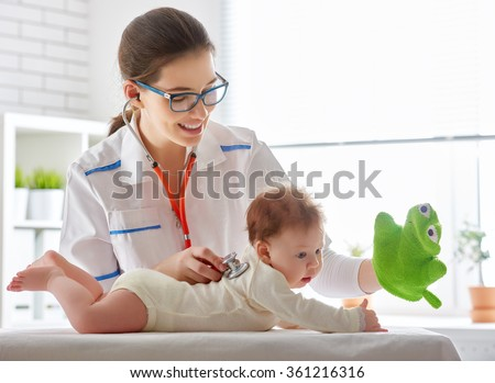 doctor examining a baby in a hospital - stock photo