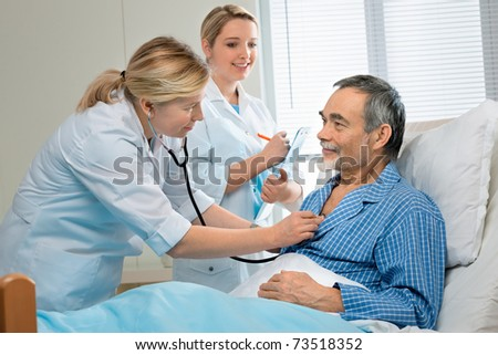 doctor examining a senior patient in hospital - stock photo