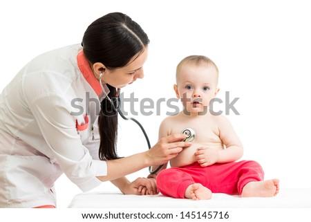 doctor examining baby girl - stock photo