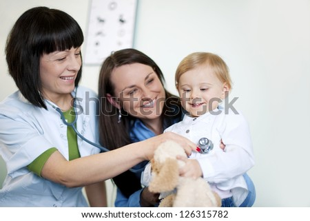 Doctor examining child - stock photo