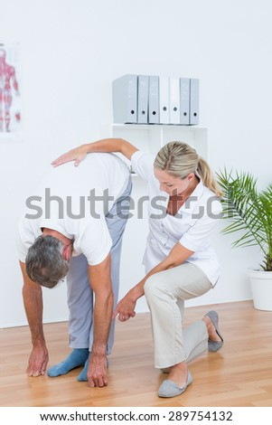 Doctor examining her patient back in medical office - stock photo