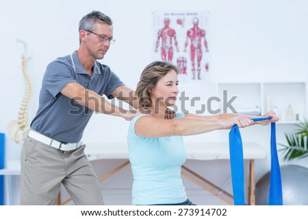 Doctor examining his patient back in medical office - stock photo