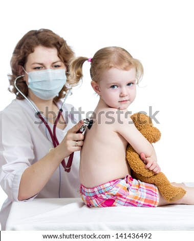 doctor examining kid girl - stock photo