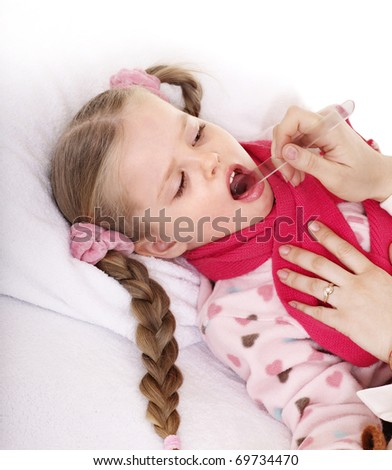 Doctor exams child with sore throat. - stock photo