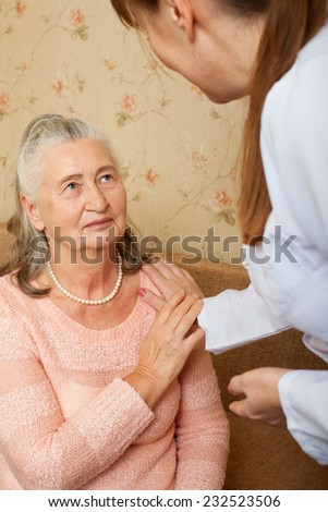 Doctor explaining diagnosis to his female patient. Concept of health care for elderly old people, disabled. - stock photo
