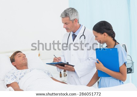 Doctor explaining report to patient in the hospital
