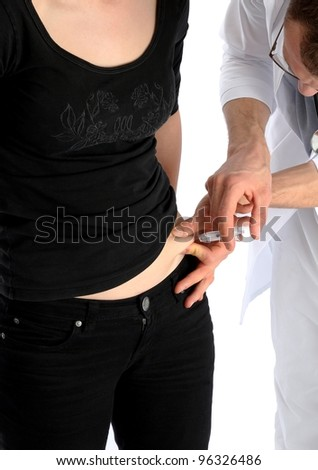 Doctor gives a syringe against thrombosis - stock photo