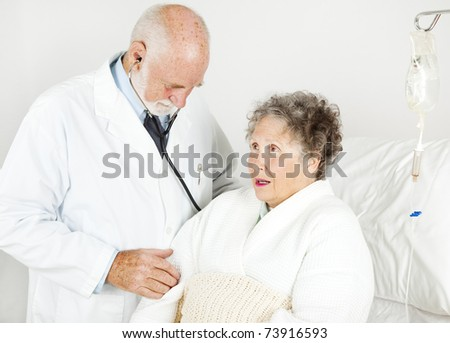 Doctor gives his hospital patient a medical examination. - stock photo
