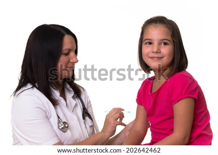 Doctor gives vaccination to a cute girl. Focus is on girl. - stock photo