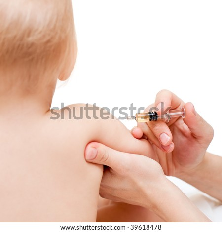 Doctor giving a child an intramuscular injection in arm, shallow DOF - stock photo