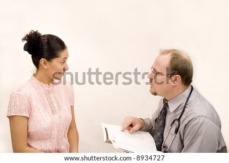 Doctor giving consultation or results to hispanic woman - stock photo